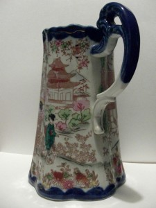 After treatment, handle reattached to Japanese ceramic jug